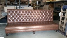 Here is a tufted bench we made new. http://wardell-upholstery.com/