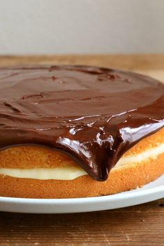 An American classic, Boston cream pie isn't a pie at all Its base is an old-fashioned hot milk cake, a downy-soft, buttery yellow cake How you whip the eggs and the sugar is critical, as the tiny air bubbles they produce add lift to the finished product
