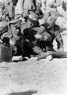 4 July 1942: Strategic planning in the desert in Tobruk, North Africa. Field Marshal Rommel talks to the Italian Chief of Staff Cambara (m) and General Calvi (r) about the employment of German and Italian troops to follow the fleeing enemy on the Egyptian border.