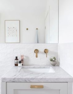 Create the illusion of more space with a large mirror, low tub and all-white tile. Decor Inspiration, Bathroom Inspiration, Bathroom Ideas, Bathroom Plants, Bathroom Colors, Family Bathroom, Master Bathroom, Gold Bathroom, Bathroom Mirrors