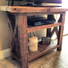 Barn Wood TV stand. Fits this 42in TV perfect. We can custom this piece to fit any size TV. $299.  For more barn wood furniture go to www.reworkshoptn.com.