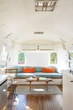Cute Airstream camper van with wood floors and teal accents Airstream Living, Airstream Remodel, Airstream Renovation, Airstream Interior, Vintage Airstream, Airstream Trailers, Travel Trailers, Vintage Campers, Vintage Trailers