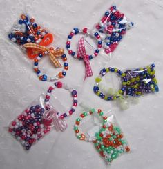 Bracelets with a kit for the girls to make a matching necklace. I try to include color-coordinated hair supplies.
