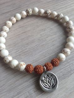 Howlite & Rudraksha Seed Lotus Mala Bracelet, Stacking Bracelet, Stretch Bracelet, Yoga Bracelet, Beaded Bracelet by SaltAndMoon on Etsy