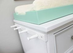 Reveal: Cool and Calm Nursery So smart! Attach a peg rail to the side of your changing table/dresser for added storage.So smart! Attach a peg rail to the side of your changing table/dresser for added storage. Dresser Storage, Nursery Storage, Nursery Organization, Organization Ideas, Closet Organization, Baby Storage, Extra Storage, Storage Ideas, Ikea Dresser