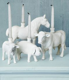 Plastic animal toys painted white with a candle inserted adorable country kitchen decor
