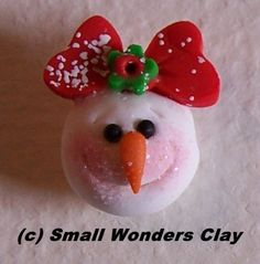Snow Lady, handmade polymer clay bead or hair bow center. $3.00, via Etsy.
