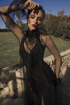 Very tight body hugging tube dress. Glamorized in black beaded rocks around the entire neckline.