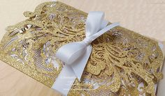 This wedding invitation is simply magical. Glam, luxurious, sparkly, with Gold or Silver glitter covers. We love their simplicity and their opulence at the same time. These wedding invitations are created with glittery gold or silver card. Your wedding details carefully designed and printed by us, proudly servicing worldwide for over a decade. Perfect for elegant, shiny weddings, ball functions, black tie parties, Disney or magical themes or luxury events. The invitations have a unique lace…