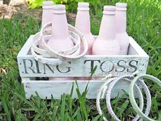Ring Toss Game  Set up a pretty ring toss game by painting the bottles and covering embroidery hoop rings with fabric.  Find out more at Two Shades of Pink.