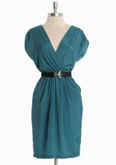 This elegant teal dress features a flattering neckline with an elasticized waistline and side pockets. Effortlessly transitions from office to weekend with statement jewelry. Removable belt. Lightweight.