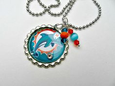 Check out this item in my Etsy shop https://www.etsy.com/listing/259935906/miami-dolphins-football-necklacemiami