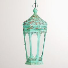 Hardwired blue Moroccan-style pendant; light is in top and looks great when lit. Library? From World Market