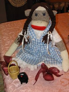 Dorothy Sock Monkey. Ruby Slippers are made from ribbon, Toto is a pompom puppy and yarn used for hair braids.
