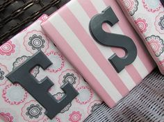 Fabric covered squares with wooden painted letters for their names