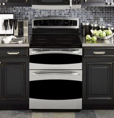Stacked Stone Backsplash With Hickory Cabinets And