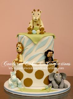 For a zoo theme party, this baby zoo animals cake is perfect & cute!