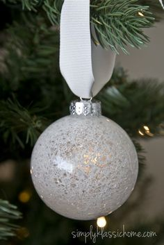 """DIY """"crackled cystal"""" snowball ornament: Add a little water to a bowl of Mod Podge, just enough to thin it out a bit. Pour a little in a clear glass ornament, swirl it around to coat the inside, and let the excess drip out. Pour some epsom salt into the ornatment (and maybe a bit of silver gitter as well?), shake it up to coat the inside of the ornament. Let dry and voila! #Snowball"""