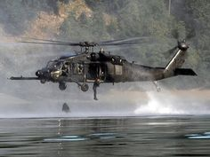A MH-60 Pavehawk drops divers into the water