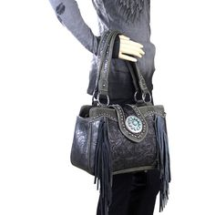 Rock your runway style with this new western fringe handbag.  Turquoise concha and tooled leather rocks your wardrobe!  Go Boho!