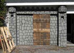 Castle walls & drawbridge.  Plywood and pallete for the drawbridge?