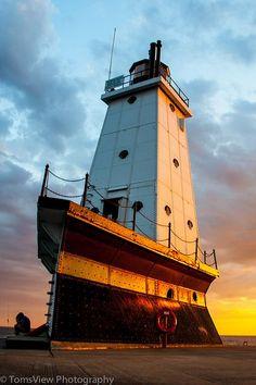 Lighthouse at Ludington, MI, USA at sunset.!