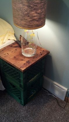 Night stand made out of old milk crates! Created a top with a recycled board from MN Barnwood!