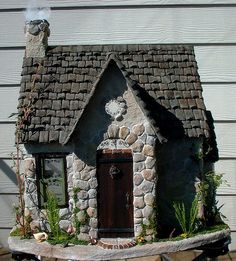 Cover Barbie house or cheap wooden birdhouses with stones, bark, etc...