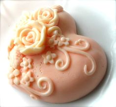 Peaches and cream heart shaped three dimensional soap with roses cascading along the front. Scented in Peaches n Cream. 3 oz. Measures 2.5x2.5.