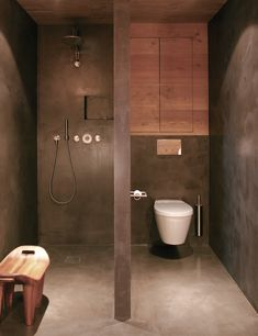 Great configuration for small space. Fan of the what looks like to be concrete finish on floors and walls