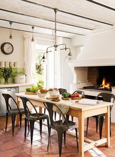 wow...what a fireplace next to the table. <3