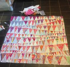 Fete, a handmade improvised patchwork quilt in progress. Bright colours and shapes inspired by summer bunting. © Stephanie Boon, 2016 www.DawnChorusStudio.com