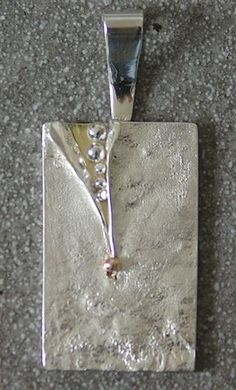 Contemporary textured (reticulated) sterling silver pendant with slash and 18kt gold. Handmade and Hallmarked #SilverJewelry
