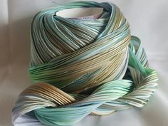 """1 yd of Abalone *current DYELOT 2nd picture* 4 wide pleated to around 1 wide silk satin bias cut ribbon.  Stunning hand dyed Shibori Ribbon from Shibori Girl Studio, Glennis Dolce. Shibori is a Japanese term for several methods of dyeing cloth with a pattern by binding, stitching, folding, twisting, or compressing it.  This technique is applied to 4"""" bias cut 100% silk satin ribbon, which is carefully pole wrapped and dyed and over-dyed multiple times to create stunning, vibrant color…"""