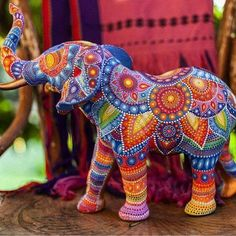 Gorgeous hand painted elephant. Lots of talent and patience needed for this quality of workmanship.