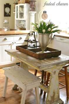 Tulips in the Kitchen.. reminds me of an old farm kitchen especially with all the light :)