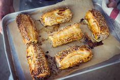 • 1 x 375g packet Carême all butter puff pastry, defrosted • 1 large red onion, finely diced • 2 cloves garlic, finely sliced • 2 teaspoon dried thyme plus extra for decorating • ¼ cup chopped flat leaf parsley • ¼ cup breadcrumbs • 1 egg beaten • 1 large apple • 500g pork mince • Salt & pepper • 1 egg beaten for egg wash • Sesame or poppy seeds for decorating