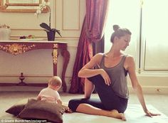 Striking a pose: Gisele Bundchen settled into a twisted yoga pose with infant daughter Vivian nearby in an Instagram photo shared on Wednesday by the Brazilian supermodel