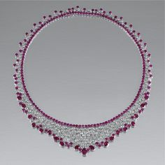 RUBY AND DIAMOND NECKLACE The fine supple mesh of bib design, set with rose-cut diamonds to an inner line of circular-cut rubies, the edges trimmed with circular-cut and oval rubies of various sizes, length approximately 400mm.