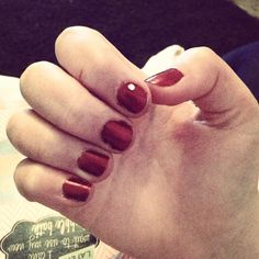 Red nails with a gem!