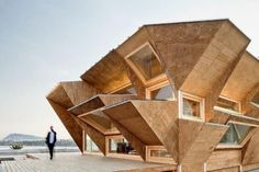 Wow, talk about creativity! This wooden house is amazing. I wonder what the inside looks like!