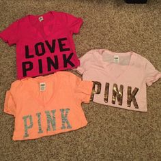 PINK short sleeve shirts All 3 from PINK! In perfect condition. Dark and light pink both size small. Orange size Medium. Light pink has gold sequins. Orange has silver glitter. PINK Victoria's Secret Tops Tees - Short Sleeve
