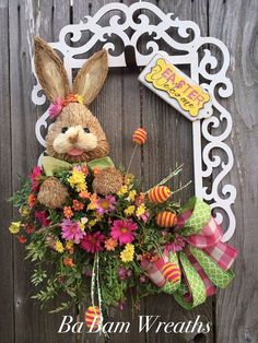 This is a reserved listing~ Easter Wreath, Easter Door Hanging, Spring Wreath, Spring Door Hanging, Easter Decor, Easter Bunny, Spring Decor Spring Bunny Welcome the season with a non-traditional wreath~ made from an XL frame and decorated with lovely florals, ribbons and a rustic cute sisal bunny!  Make your door or wall stand out~ be different and give your neighbors/family something to talk about!  Measures 26 inches in length & 20 inches wide~ and ready for immediate shipment!