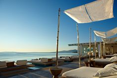 The swimming #pool #lounge area at the Cavo Tagoo in #Mykonos, #Greece www.mediteranique.com/hotels-greece/mykonos/cavo-tagoo/