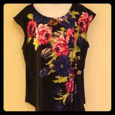 Beautiful Plus Sz Black Floral Top Black top with pink, lime green floral design has a small buckle to the side of the waist to accentuate figure,and a small pointed drop at bottom front of shirt stretchy soft satiny material, worn for abt an hr and a half no trades, no pp, price is firm unless bundled . Ashley Stewart Tops