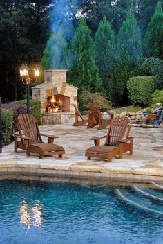 Pool, Adirondack chairs and an outdoor fireplace...perfect!