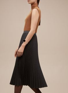A pleated wool skirt is the ultimate transitional staple.Babaton Jude Skirt, $195, available at Aritzia. #refinery29 http://www.refinery29.com/business-casual-for-women#slide-6