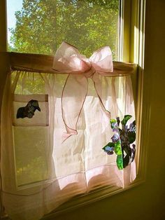 Cool idea ~ a sheer apron used for a cafe curtain!