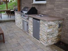 Caledonia Outdoor Kitchen and Patio - Signature Outdoor Concepts