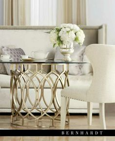 in love with this metal tone right now.  salon dining table with glass top from Bernhardt